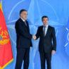 Left to right:  President Filip Vujanovic of Montenegro shaking hands with NATO Secretary General Anders Fogh Rasmussen