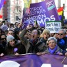 "Demonstrators shout slogans as they hold flags, placards and a banner during the ""March for Change"" planned by left-wing party Podemos that emerged out of the ""Indignants"" movement, in Madrid on January 31, 2015. Tens of thousands of people took to the streets in Madrid today in support of a call for change from new anti-austerity party Podemos, a week after Greece elected its ally Syriza. AFP PHOTO/ GERARD JULIEN        (Photo credit should read GERARD JULIEN/AFP/Getty Images)"