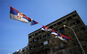 Serbian flags are seen near the main bridge in the ethnically divided town of Mitrovica