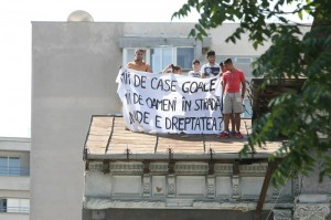 "Community members protesting in the day of the eviction. ""Thousands of empty houses, Thousands of people in the street, Where is the Justice?"""