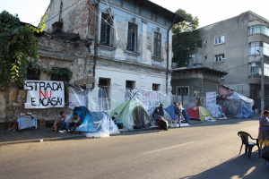 "View from a part of the camp . Banner reads: ""The street is not a Home!"""